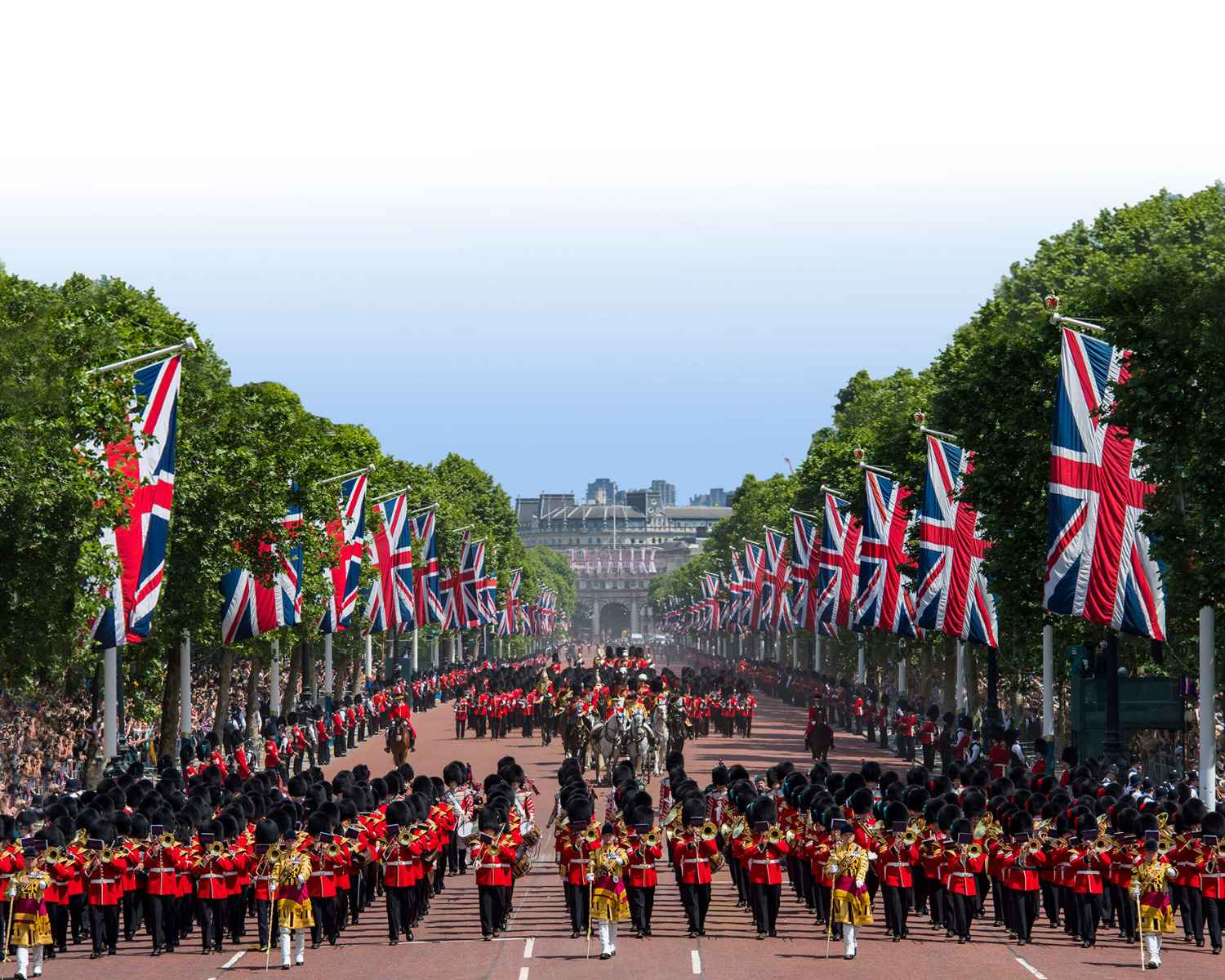 Soldiers of the Mass Bands and Household division marching in front of and behind HRH Queen Elizabeth returning back to Buckingham Palace.