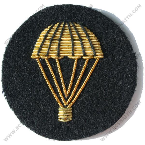 Parachute Gold On Black Badge