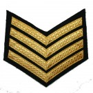 4 Bar Chevron Gold on Black Mess Badge